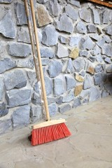 large broom on wall outdoor - housework