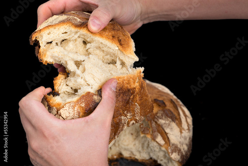 baker cutting bread