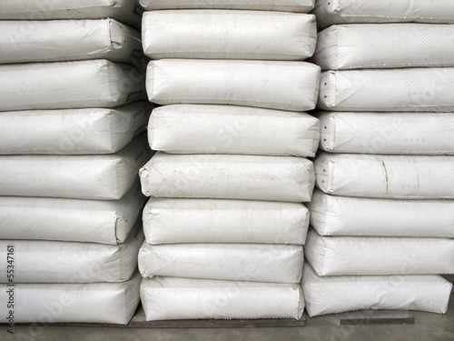 Pile of white plastic sacks in warehouse
