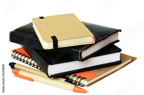 Stack of notebooksand pens