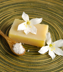 Two frangipani flower and stacked soap,
