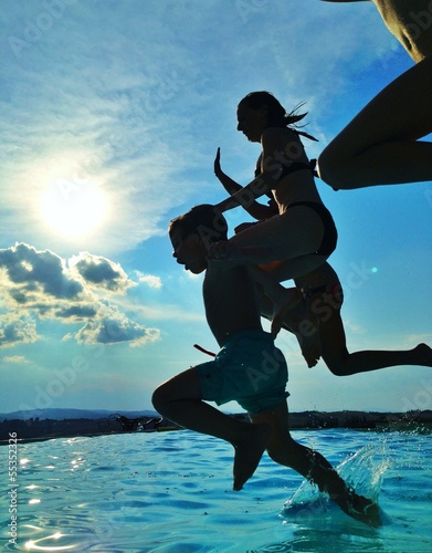 kids jumping in pool