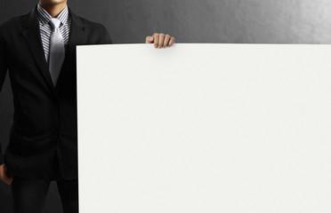 Businessman showing the big blank card
