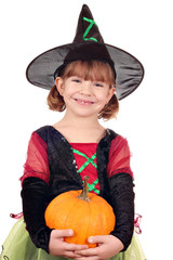 happy little girl witch with pumpkin halloween