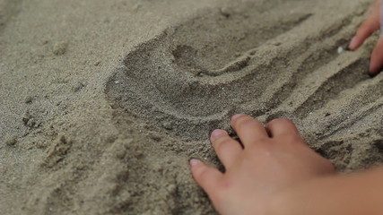 Finding a Coin in Sand