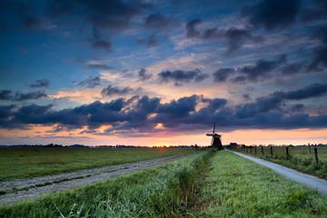 summer sunrise and Dutch windmill