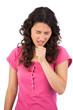 Sick attractive brunette sneezing