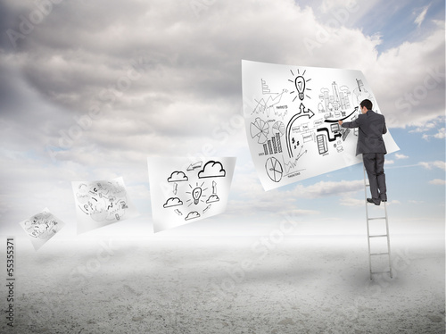 Businessman on a ladder drawing on a floating paper