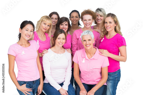 Voluntary cheerful women posing and wearing pink for breast canc