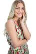 Happy pretty blonde wearing flowered dress posing