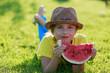 Summer joy - lovely girl eating fresh watermelon