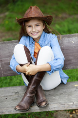 Lovely cowgirl  on a ranch