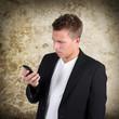 Unternehmer mit Handy
