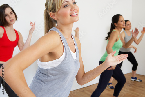 Poster Fitness Group Of Women Exercising In Dance Studio