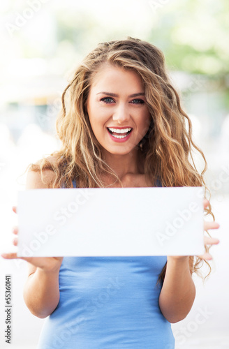 Attractive woman holding blank card