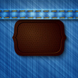 Abstract denim background with leather tag