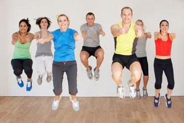 Group Of People Exercising In Dance Studio
