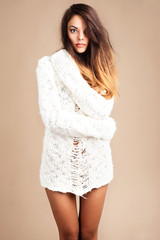 Tender woman in white woolen sweater