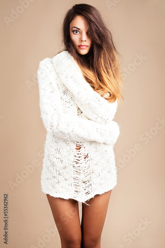 Tender woman in white woolen sweater