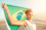 Brazilian Girl with National Flag at Beach
