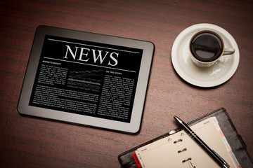 News on digital tablet.