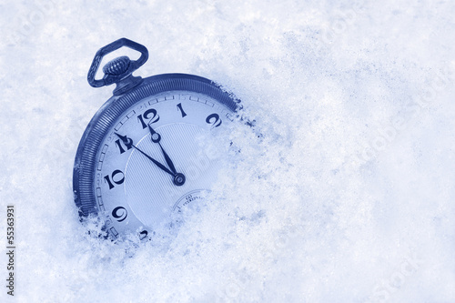 Pocket watch in snow, Happy New Year greeting card