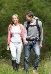 Couple Hiking In Countryside
