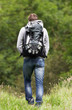 Rear View Of Man Hiking In Countryside
