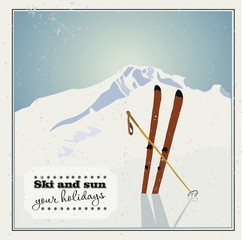 Winter  background. Mountains and ski equipment in the snow