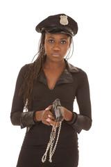 Cop woman with gun cuffs look serious
