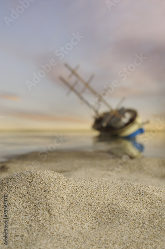 Beach in low tide with fishing boat