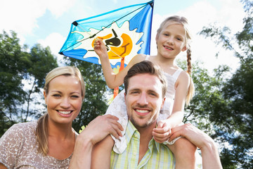 Family Flying Kite In Countryside