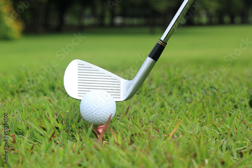 Teeing off in a game of golf, differential focus with copy space