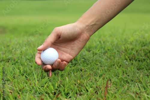 golfer teeing up a golf ball