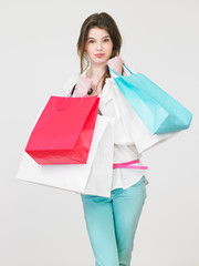 Studio Shot Of Teenage Girl With Shopping Bags