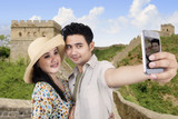 Asian couple take picture at Great Wall China