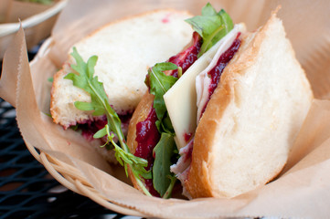 Smoked turkey and cranberry sauce sandwich
