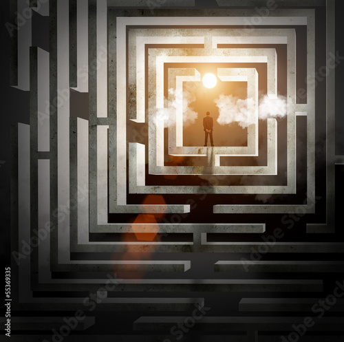 Silhouette of businessman in maze