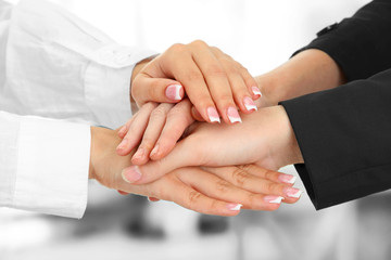 United hands, on office background