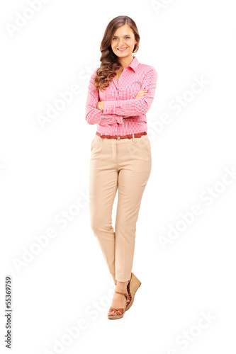 Full length portrait of a smiling female posing and looking