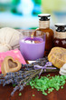 Still life with lavender candle, soap, massage balls, bottles,