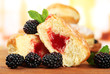 Tasty donuts with berries on wooden table
