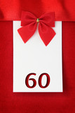 Number sixty on red greeting card