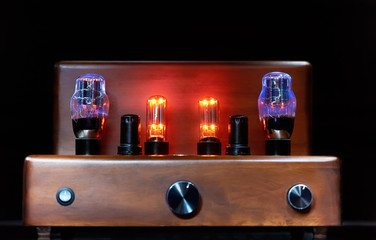 electronic amplifier with glowing bulb lamp