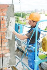 facade builder plasterer at work