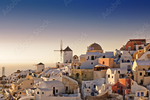Oia white houses and windmills at sunset