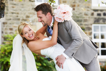 Romantic Bride And Groom Embracing Outdoors