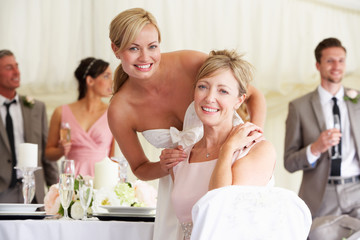 Bride With Mother At Wedding Reception