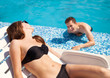 Couple in love near swimming pool