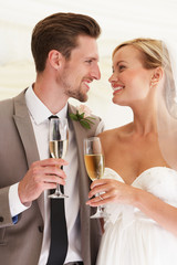 Bride And Groom Drinking Champagne At Wedding